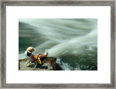 Watching The Rushing Water Framed Print