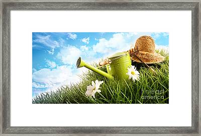 Water Can And Straw Hat Laying In Grass Framed Print by Sandra Cunningham