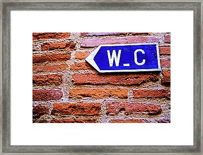 Water Closet Sign On A Brick Red Wall Framed Print by Sami Sarkis