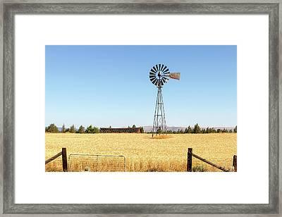 Water Pump Windmill At Wheat Farm In Rural Oregon Framed Print by David Gn
