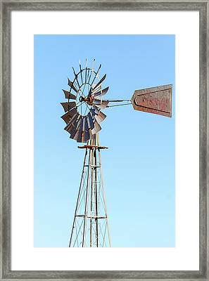 Water Pump Windmill On Blue Sky Background Framed Print by David Gn