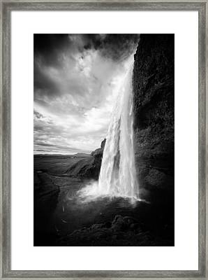 Framed Print featuring the photograph Waterfall In Iceland Black And White by Matthias Hauser