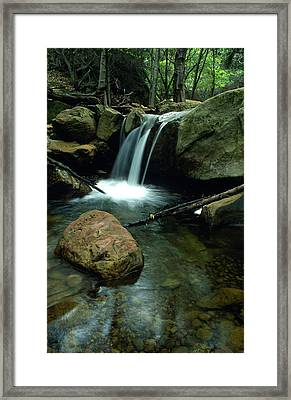 Waterfall In The Woods Framed Print by Kathy Yates