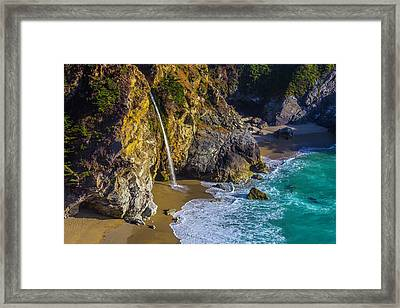 Waterfall Pouring Into The Ocean Framed Print by Garry Gay