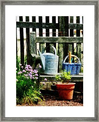 Watering Can And Blue Basket Framed Print