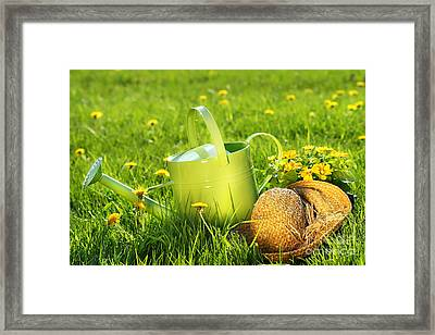 Watering Can In The Grass Framed Print
