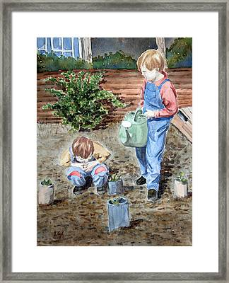 Watering The Plants Framed Print by John Cox