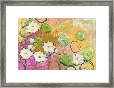 Waterlillies At Dusk Framed Print by Jennifer Lommers