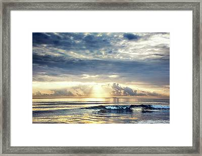 Wave At Dawn Framed Print by Debra and Dave Vanderlaan