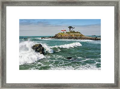 Framed Print featuring the photograph Wave Break And The Lighthouse by Greg Nyquist