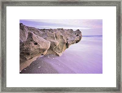 Waves Against Rock Framed Print