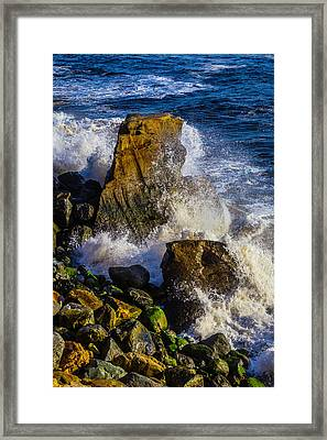 Waves Battering Rocks Framed Print by Garry Gay