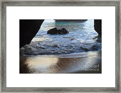 Waves From The Cave Framed Print by Angelo DeVal