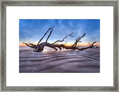 Waves In The Sand Framed Print by Debra and Dave Vanderlaan