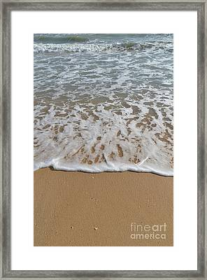 Waves Meet The Sand Framed Print by Angelo DeVal