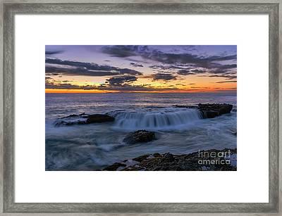 Wave Over The Rocks Framed Print by Eddie Yerkish