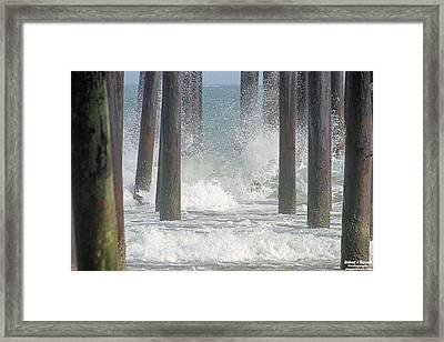 Waves Under The Pier Framed Print