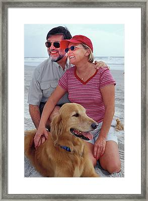 We Love Our Dog Framed Print by Carl Purcell