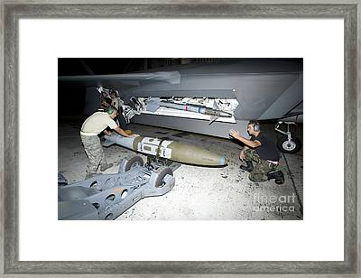 Weapons Loaders Load A Gbu-32 Jdam Framed Print by HIGH-G Productions
