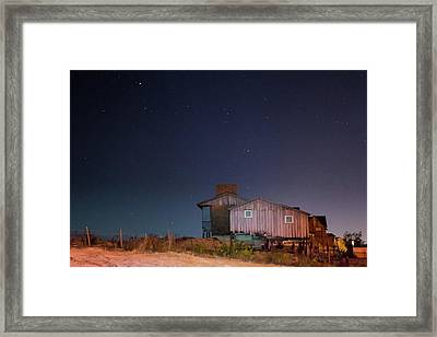 Weather Worn Beach House Against Starry Midnight Blue Sky Framed Print by Tim Bond