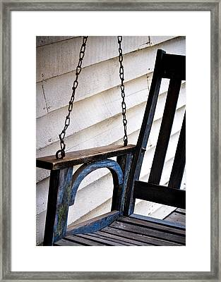 Weathered Porch Swing Framed Print by Debbie Karnes