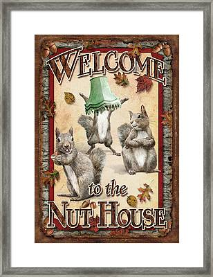 Welcome To The Nut House Framed Print by JQ Licensing