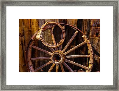 Western Rope And Wooden Wheel Framed Print