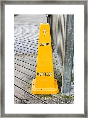 Wet Floor Warning Framed Print by Tom Gowanlock