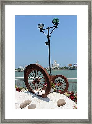 Wheels By The Water Framed Print
