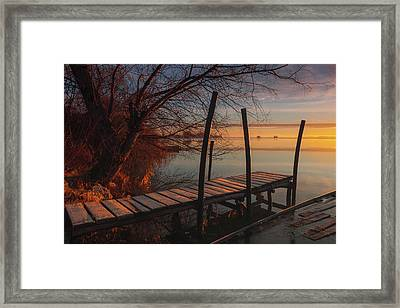 When The Light Touches The Shore Framed Print