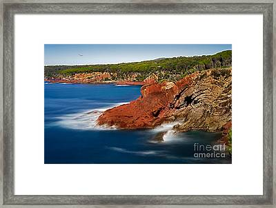 Where Blue Water Meets Red Rock Framed Print by Russ Brown