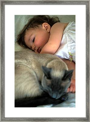 While Baby Sleeps Framed Print by Kathy Yates