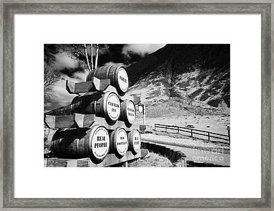 Whisky Barrels Outside The Clachaig Inn Glencoe Highlands Scotland Uk Framed Print by Joe Fox
