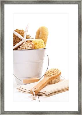 White Bucket Filled With Sponges And Scrub Brushes  Framed Print by Sandra Cunningham