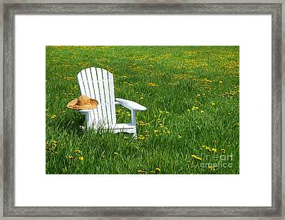 White Chair With Straw Hat Framed Print