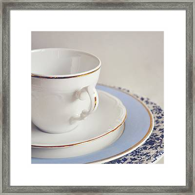 Framed Print featuring the photograph White China Cup, Saucer And Plates by Lyn Randle