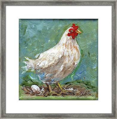 White Hen Lays Egg Framed Print