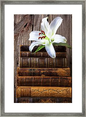 White Lily On Antique Books Framed Print by Garry Gay