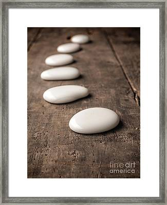 White Stones On Wood Framed Print by Andreas Berheide