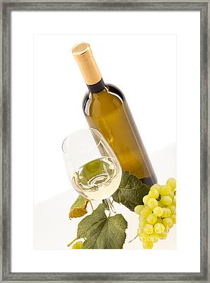 White Wine In Glass With Grapes And Bottle Framed Print by Wolfgang Steiner