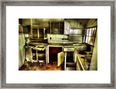 Who Left The Cupboard Doors Open Framed Print by Michael Eingle