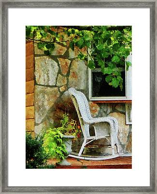 Wicker Rocking Chair On Porch Framed Print by Susan Savad