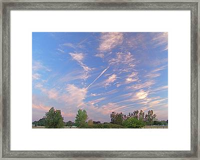 Wild And Crazy Sky Framed Print by John Norman Stewart
