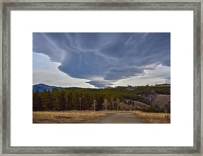 Wild Clouds In The Mountains Framed Print