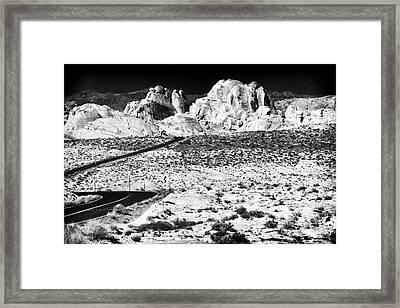 Winding In The Desert Framed Print by John Rizzuto