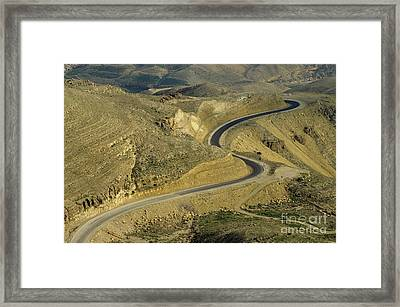 Winding  King Road In Wadi Mujib Valley Framed Print by Sami Sarkis