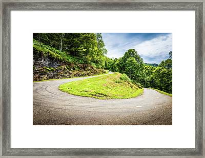 Framed Print featuring the photograph Winding Road With Sharp Curve Going Up The Mountain by Semmick Photo