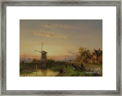 Windmill At Sunset Framed Print