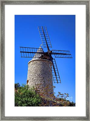 Framed Print featuring the photograph Windmill In Provence by Olivier Le Queinec