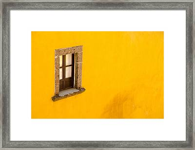 Window On A Yellow Wall. Framed Print